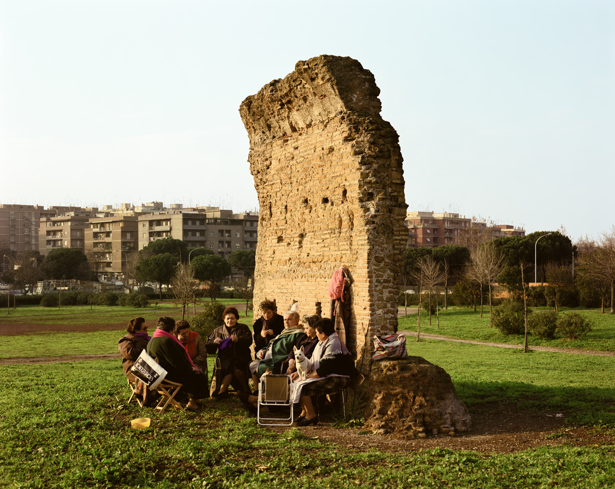 Joel Sternfeld, 'Women at a daily gathering beside an ancient Roman wall, Parco dei Gordiani, Rome, October', 1990