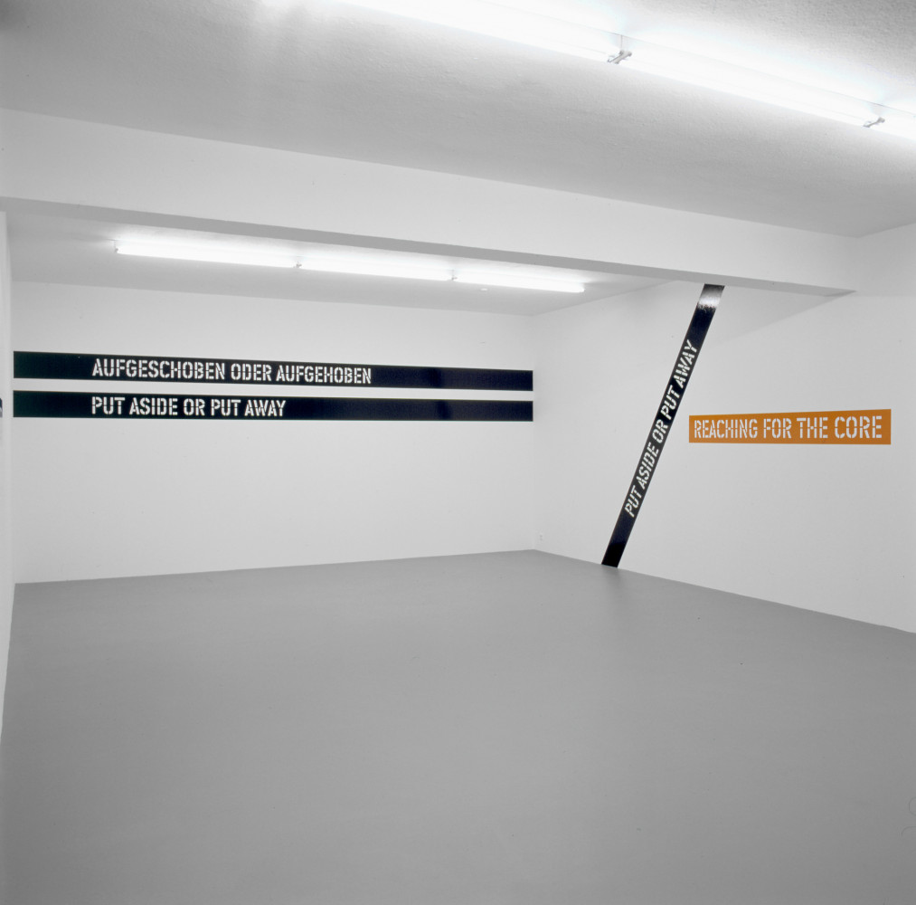 Lawrence Weiner, 'AUFGESCHOBEN ODER AUFGEHOBEN NACH DEM KERN GREIFEN PUT ASIDE OR PUT AWAY REACHING FOR THE CORE', Installation view, 2002