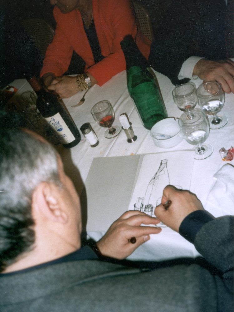 'Salvo drawing during the aftershow dinner at Buchmann Galerie Cologne, 1997'